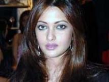 https://www.filmibeat.com/img/2009/12/15-riya-sen-151209.jpg