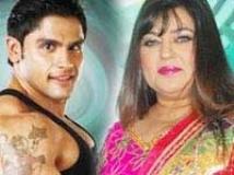 https://www.filmibeat.com/img/2010/11/26-dolly-rahul-bhatt-261110.jpg