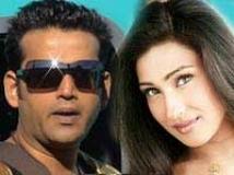 https://www.filmibeat.com/img/2011/01/10-rituparna-ravi-kishan-10011.jpg
