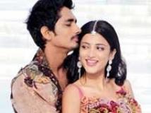 https://www.filmibeat.com/img/2011/02/22-shruti-hassan-siddharth-220.jpg