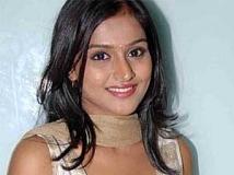 https://www.filmibeat.com/img/2011/05/12-remya-nambeesan-120511.jpg