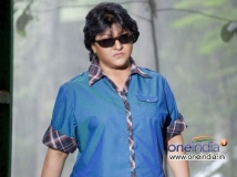 https://www.filmibeat.com/img/2014/01/03-03-1388744754-kannada-movie-gharshane-0.jpg
