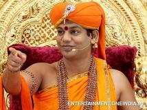 https://www.filmibeat.com/img/2014/05/19-nithyananda-01.jpg