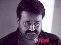 https://www.filmibeat.com/img/2014/10/06-mohanlal-padmabhushan.jpg