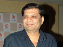 https://www.filmibeat.com/img/2014/11/12-ravi-chopra.jpg