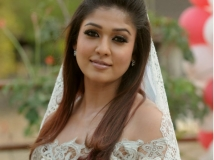 https://www.filmibeat.com/img/2015/02/10-1423552466-nayanatarawedding.jpg