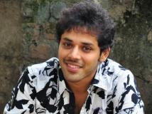 https://www.filmibeat.com/img/2015/02/25-1424862216-actor-nandu-stylish-pics-4.jpg