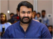https://www.filmibeat.com/img/2018/06/mohanlal-1529298160.jpg
