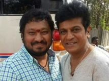 https://www.filmibeat.com/img/2019/01/09-1428567768-shivarajkumar-r-chandru-1546490653.jpg