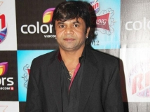 https://www.filmibeat.com/img/2019/06/rajpal-yadav-1559758908.jpg