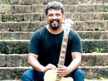 https://www.filmibeat.com/img/2019/08/raghu-dixit-5-1565257289.jpg