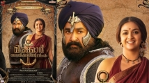 https://www.filmibeat.com/img/2020/01/marakkar-arabikadalinte-simham-keerthy-suresh-character-poster-1579436423.jpg
