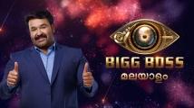 https://www.filmibeat.com/img/2020/03/bigg-boss-logo-1583211602-1584422404.jpg