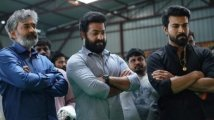 https://www.filmibeat.com/img/2020/03/rrr-the-title-motion-poster-of-the-ram-charan-jr-ntr-ss-rajamouli-project-to-be-out-on-march-24-1585072617.jpg