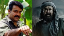 https://www.filmibeat.com/img/2020/07/mohanlal-marakkar-arabikadalinte-simham-delayed-again-to-release-only-after-drishyam-2-1593799741.jpg