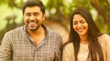 https://www.filmibeat.com/img/2020/07/nivin-pauly-and-aishwarya-lekshmi-to-team-up-again-for-bismi-special-1595009714.jpg