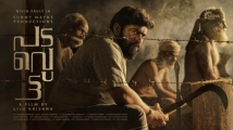 https://www.filmibeat.com/img/2020/07/nivin-pauly-reveals-padavettu-first-look-poster-1595178564.jpg