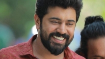https://www.filmibeat.com/img/2020/08/nivin-pauly-i-want-to-experiment-with-different-roles-1597342695.jpg