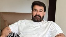 https://www.filmibeat.com/img/2020/11/mohanlal-loses-cool-after-amma-executive-meeting-refuses-to-address-media-1606000953.jpg