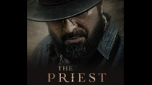 https://www.filmibeat.com/img/2021/01/the-priest-mammootty-s-new-poster--1610216659.jpg