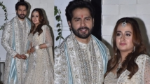 https://www.filmibeat.com/img/2021/01/varun-dhawan-and-natasha-dalal-s-mumbai-reception-here-is-everything-you-need-to-know-1611513896.jpg