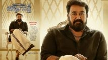 https://www.filmibeat.com/img/2021/01/mohanlal-reveals-new-poster-of-aaraattu-1610129981.jpg