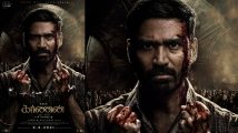 https://www.filmibeat.com/img/2021/02/karnan-first-look-is-out-dhanush-wins-the-internet-with-his-intense-look-1613281226.jpg