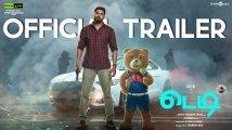 https://www.filmibeat.com/img/2021/02/teddy-trailer-arya-sayyeshaa-1614122823.jpg