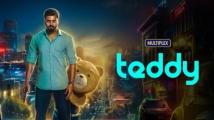 https://www.filmibeat.com/img/2021/03/teddy-movie-review-1615515699.jpg