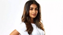 https://www.filmibeat.com/img/2021/05/poojahegde-1620293435.jpg