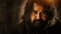 https://www.filmibeat.com/img/2021/05/mohanlal-marakkar-theatre-release-1621727880.jpg