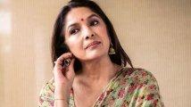 https://www.filmibeat.com/img/2021/06/neena-1623839235-1624105177.jpg