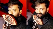 https://www.filmibeat.com/img/2021/07/manikuttan-wins-bigg-boss-malayalam-3-1627150130.jpg