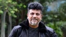 https://www.filmibeat.com/img/2021/07/shivarajkumar-1626029669.jpg