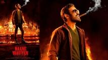 https://www.filmibeat.com/img/2021/10/naane-varuven-dhanush-october-16-1634232581.jpg