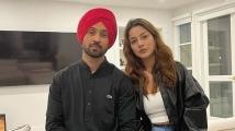 https://www.filmibeat.com/img/2021/10/shehnaazdiljit-1634100979.jpg