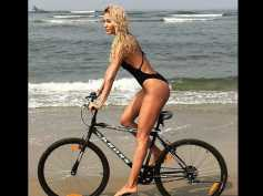 Swimsuit-clad Lisa Haydon Rides A Cycle On The Beach In Goa! View Pictures