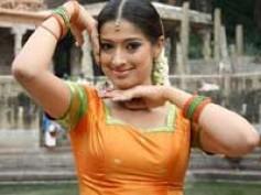 Lakshmi Rai as Mohanlal's wife