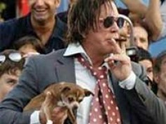 Mickey Rourke's pooch bit him at first meeting