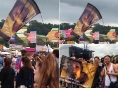 Kim Kardashian & Ray J's Tape Pic Waved On A Flag at Kanye's Glastonbury Show