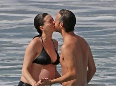 Anne Hathaway Shows Off Her Baby Bump In A Bikini While Sharing A Kiss With Husband Adam!
