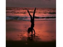 Lisa Haydon Does A Flip On The Beach Wearing A Bikini
