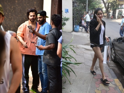 Varun Takes Selfies With Fans After Gym; Janhvi Out Shopping