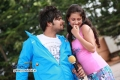 Pradeep and Kanika Tiwari in Kannada Movie Rangan Style