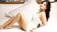 Sunny Leone Laying on Bed