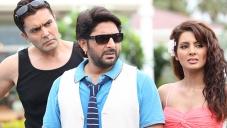 Arshad Warsi and Geeta Basra still from film Mr Joe B Carvalho