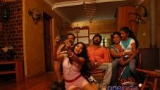 Devika and Vignesh still from film Poonai
