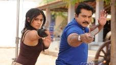 Priyamani and Sarathkumar still from film Anjatha Chandi