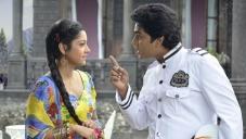 Puja Gupta and Navin Prabhakar still from Samrat And Co