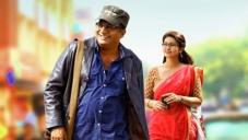 Prakash Raj and Actress Sneha in Un Samayal Arayil